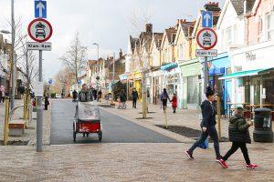 People walking and cycling along Francis Road, Leyton